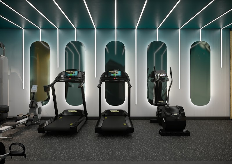 three treadmills against a wall with mirrors